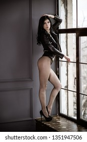 Sexy woman in dark lingerie at vintage interior. Lady with thin figure, long legs, sex concept