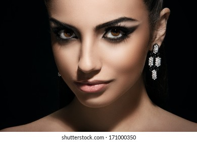 Sexy woman with earring and cute makeup