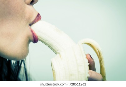 Sexy woman eating banana, sensual lips with banana, Blowjob concept