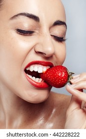 Sexy Woman Eating Strawberry. Sensual Lips. Manicure and Lipstick. Desire. Beauty Girl Sexy Lips with Strawberry. white teeth