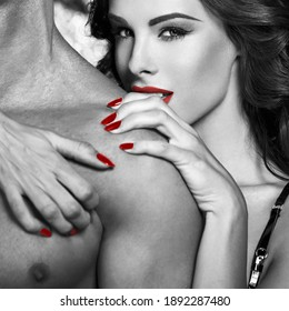 Sexy woman embrace naked man shoulder, black and white with red selective coloring,  bdsm