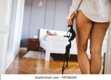 Sexy woman getting ready for sex in bedroom