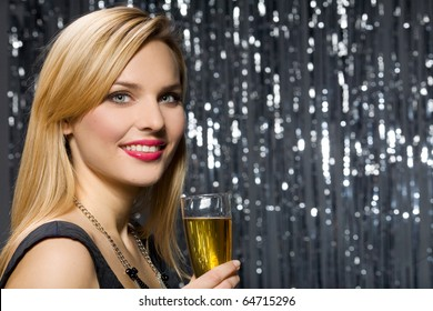 Sexy woman with glass of champagne