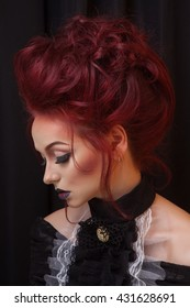 sexy woman with gothic makeup and red hair