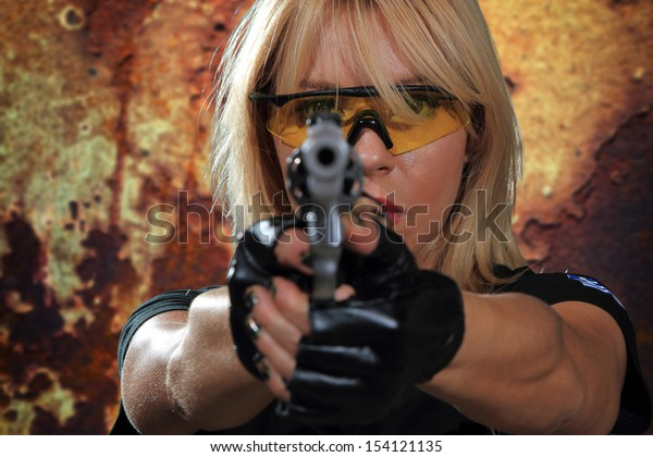 Sexy woman with gun over grunge background