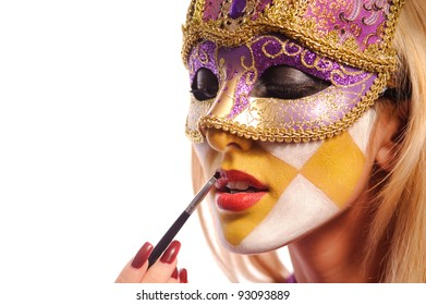 sexy woman in half mask from Venice brush her lips, isolated on white. may be use for fashion make-up concept