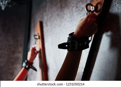 Sexy woman in handcuffs. Games for adults in the room BDSM.  - Shutterstock ID 1231050214