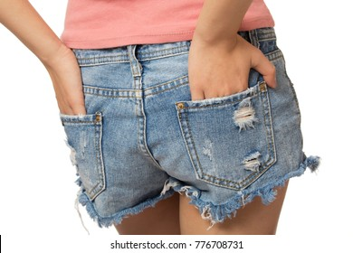 Sexy woman with her hands in her back pocket isolated on a white background