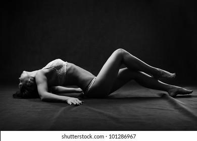 Sexy woman lay on the floor. Studio shot