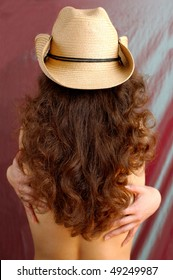 Sexy woman with long brown hair in cowboy