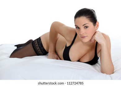 Sexy woman lying on a bed