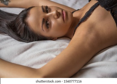 sexy woman lying on bed at home close up