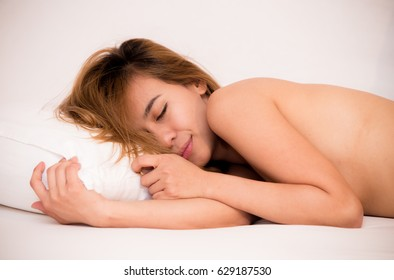 Sexy woman lying on bed in bedroom