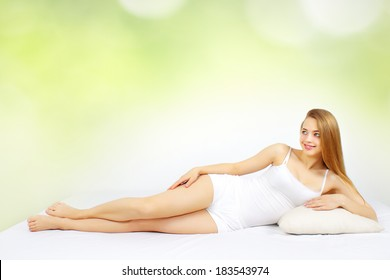 Sexy woman lying on the white bed