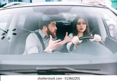 Sexy woman and man in car. woman at the wheel. front view