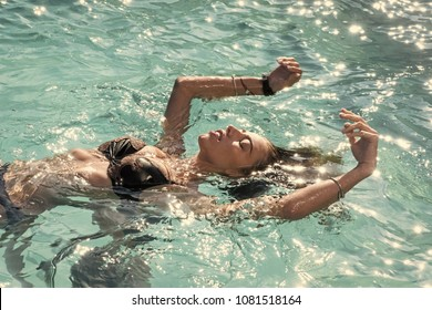 Sexy woman on Caribbean sea in Bahamas. Relax in spa swimming pool, refreshment and skincare. Maldives or Miami beach water. Beauty of woman is moisturized in bath. Summer vacation and travel to ocean