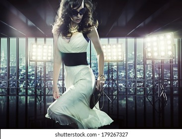 Sexy woman over city background