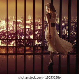 Sexy woman over night city background