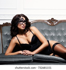 Sexy woman posing in erotic lingerie over vintage background