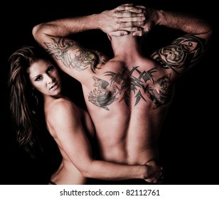 Sexy Woman pressed up against a man with tattoos