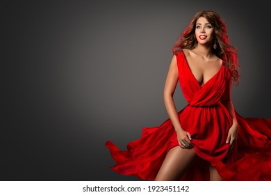 Sexy Woman in Red Dress dancing. Fashion Beauty Party Dancer. Model Club Make up and Hairstyle. Copy Space over Black Background