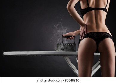 sexy woman with  retro iron on black background