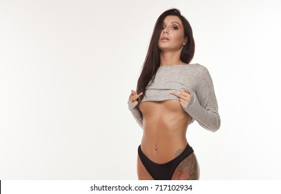 Sexy Woman shows Fuck you Sign White Background