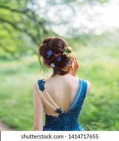 sexy woman silhouette fashionable hairstyle decorated flowers long red hair hairdresser, summer nature image  graduation prom wedding, forest nymph in water color blue dress art back without face