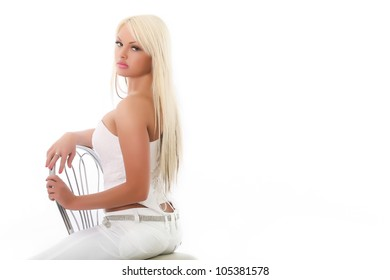 sexy woman sitting on a chair, isolated on the white