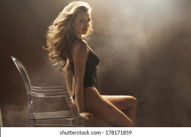 Sexy woman sitting on the crystal chair