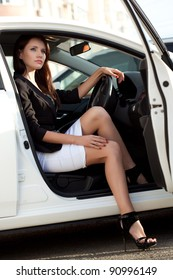sexy woman sitting in white car