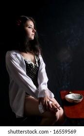 Sexy woman smoking cigarette