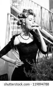 sexy woman smoking a Cuban cigar - fashion shoot (intentional soft focus and vintage look)