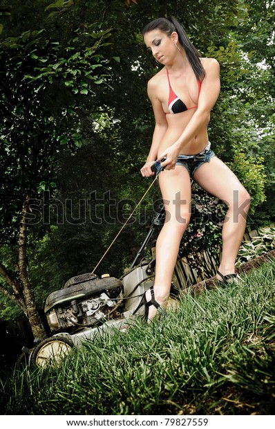 Sexy Woman Starting Lawn Mower Stock Photo Edit Now 79827559
