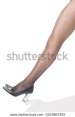 d4b87fcfee3 Sexy woman straight legs in black tights in grid with polka dots in dark  blue shoes