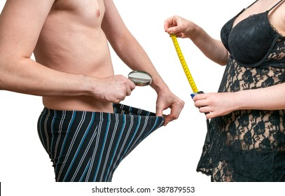 Sexy woman with tape is going to measure size of her lovers penis. Isolated on white background.