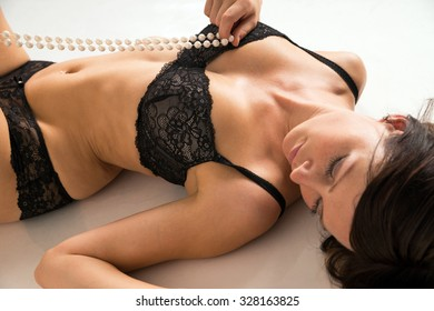 sexy woman in underwear and with pearl necklace / sexy woman