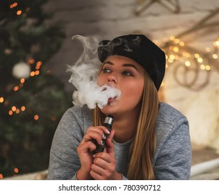 Sexy woman is vaping.christmas interior