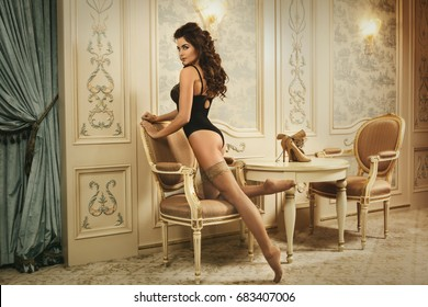 Sexy woman wearing beautiful lingerie and a stockings in the luxury interior