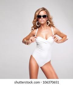 Sexy woman wearing white swimsuit