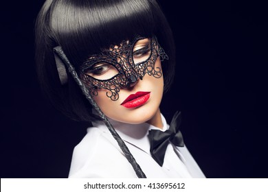 Sexy woman with whip and mask, bdsm