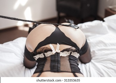 Sexy woman with whip on ass, bdsm
