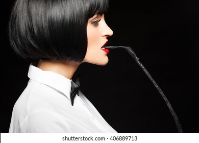 Sexy woman in wig bite whip, bdsm
