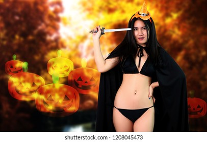 sexy woman witch in black bikini and halloween background