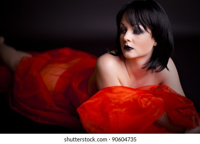 Sexy woman wth creative makeup on black background