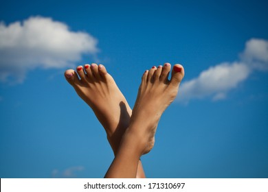 Sexy Woman's Legs with fashion nails. Summer holidays.