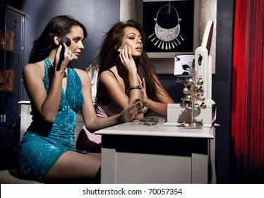 Sexy women doing make up
