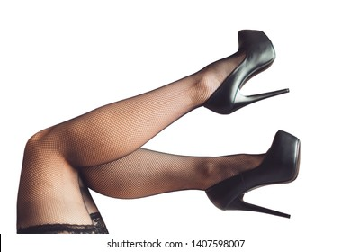 sexy women's legs in black fishnet stockings texture. young fashion woman in fishnets and high heels