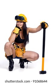 Sexy worker posing against a white background with hammer