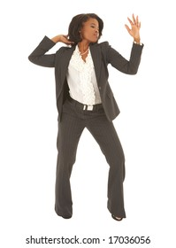 Sexy young adult african businesswoman in a business suit on a white background, dancing. NOT ISOLATED